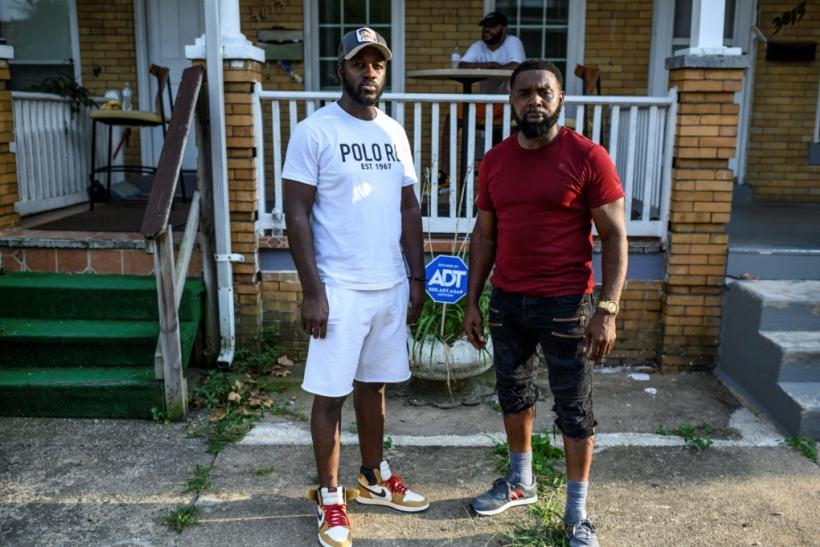 Baltimore resident and gunshot survivor Antonio Pinder (L) gets much needed support from his uncle and best friend Lamont Medley (R)
