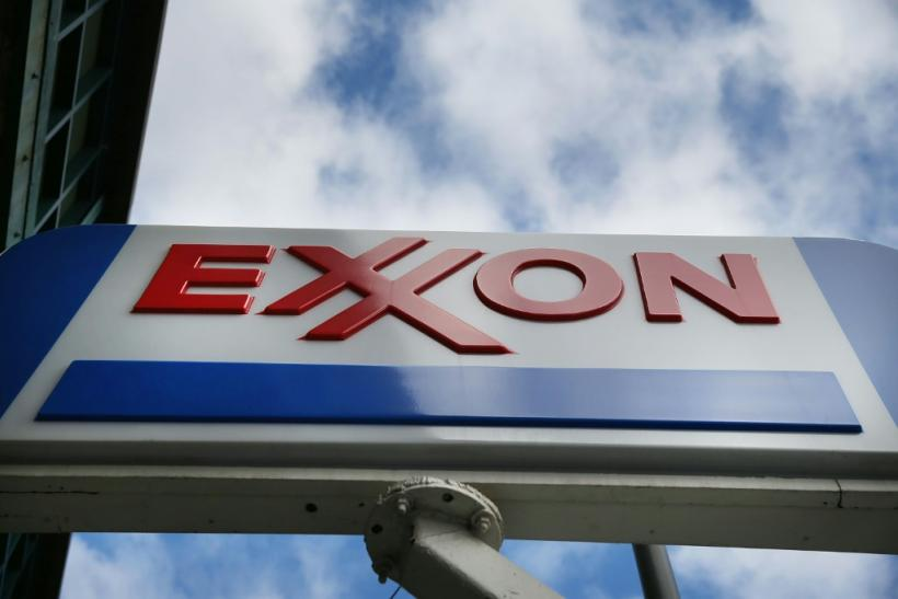 Exxon Mobil reported a sharp drop in third-quarter profits on lower oil prices, even as increased investment in US shale projects boosted output