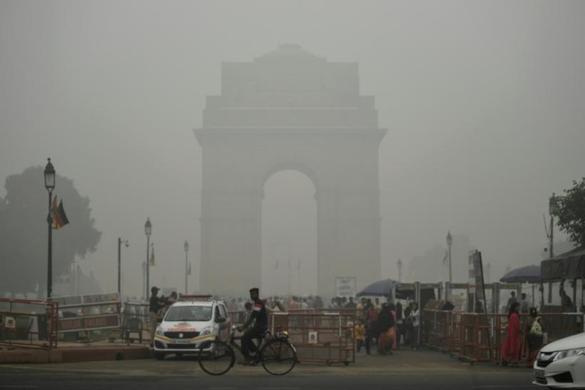 India Gate in New Delhi is pictured through a choking smog that has blanketed the capital