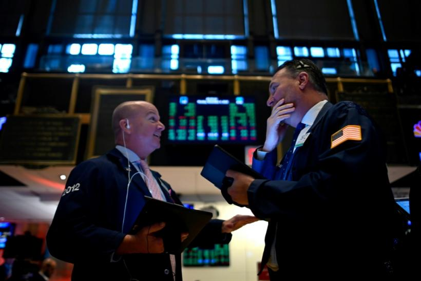 Traders work during the opening bell at the New York Stock Exchange (NYSE) on November 4, 2019 in a session that would produce records for the Dow, S&P 500 and Nasdaq