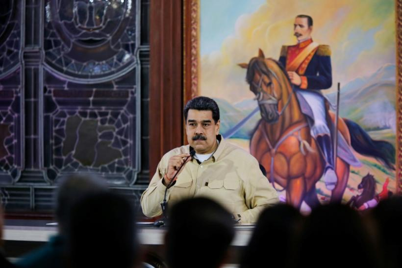 The United States claims the government of Venezuelan President Nicolas Maduro, shown here in a handout photo, is getting rich through drug trafficking