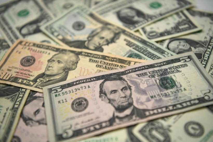 US bank notes. The bank robber reportedly shouted 'Merry Christmas' and threw the stolen cash in the air