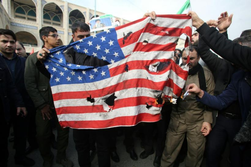 "Iranians burn a US flag during a demonstration against American ""crimes"""