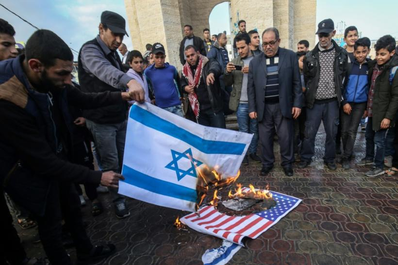 Palestinians demonstrated against the US plan in the West Bank and Gaza, with protesters burning Israeli and US flags on Saturday in the town of Rafah, in the Gaza Strip