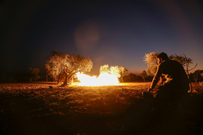 A Syrian rebel fires a rocket towards regime forces positions in the southern countryside of Aleppo