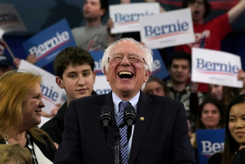 Senator Bernie Sanders celebrates with supporters after US networks declare him winner of the New Hampshire primary, a critical early test in the Democratic battle for the right to face President Donald Trump in November