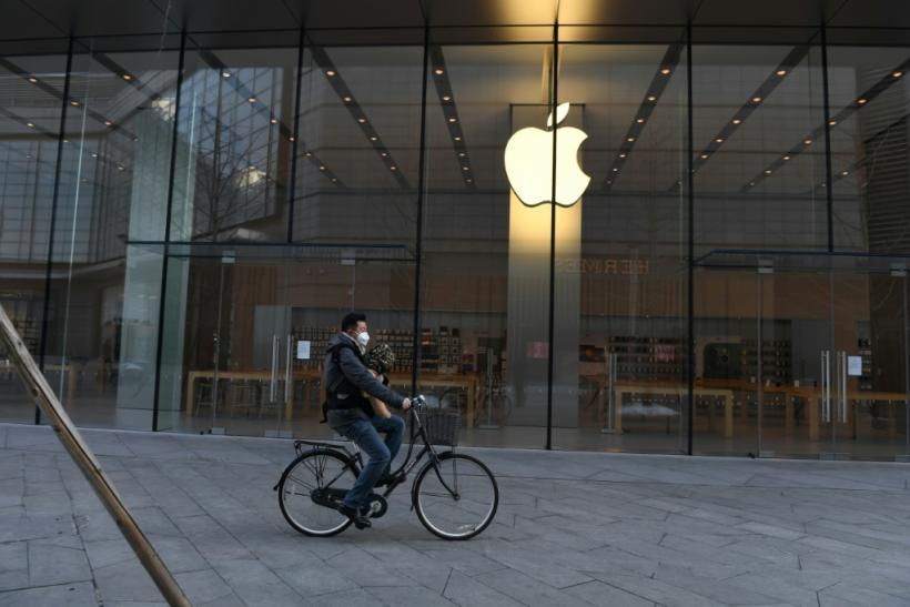A man cycles past a closed Apple store in Beijing on February 8