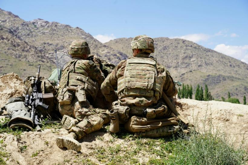 US soldiers look out over hillsides during a visit of the commander of US and NATO forces in Afghanistan in 2019