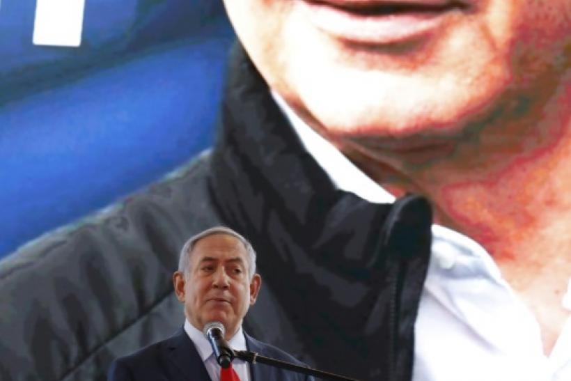 Israeli Prime Minister Benjamin Netanyahu speaks near Tel Aviv on the eve of elections