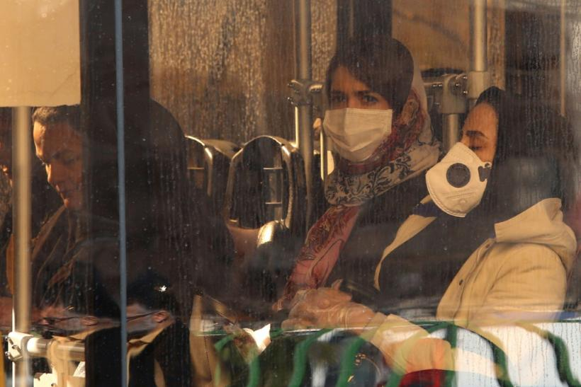 Iranian women wearing protective masks while riding a bus in the Iranian capital Tehran