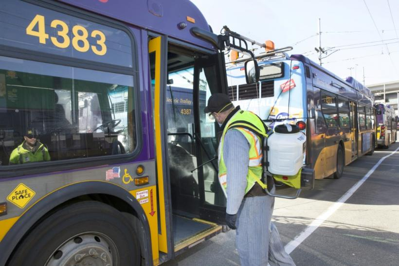 An equipment service worker for King County Metro sprays a disinfectant, throughout a metro bus in Seattle, Washington, a new focal point for the coronavirus epidemic