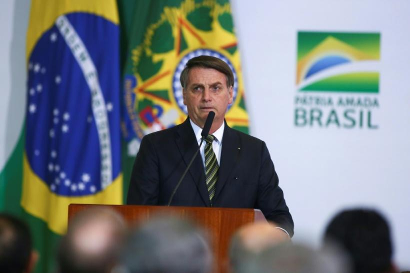 Brazilian President Jair Bolsonaro (C) is set to travel to the United States March 7, 2020