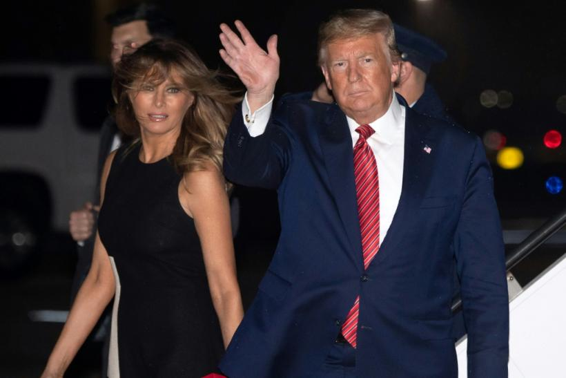 US President Donald Trump, shown here with his wife Melania arriving in Palm Beach on February 14, 2020, handed control of the Trump Organization over to his sons after his inauguration