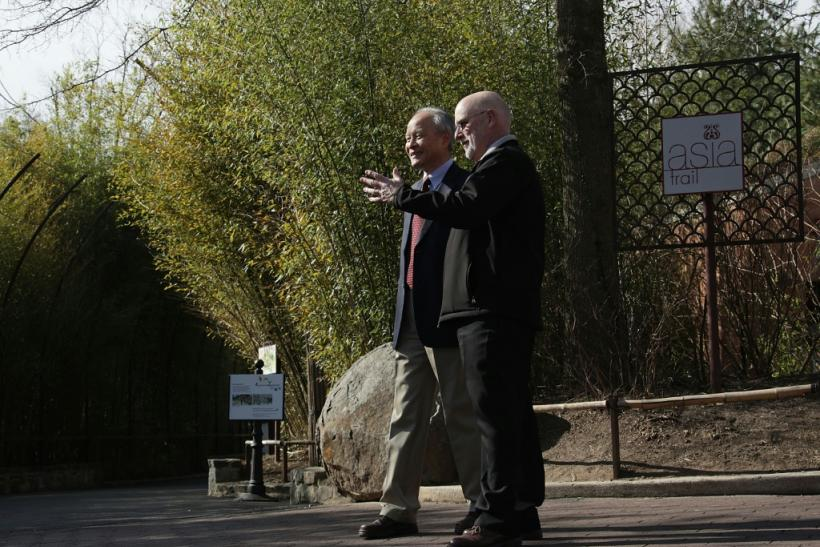 Chinese Ambassador Cui Tiankai (left) speaks to the director of the National Zoo, Dennis Kelly, as they wait for the departure of giant panda Bao Bao in February 2017