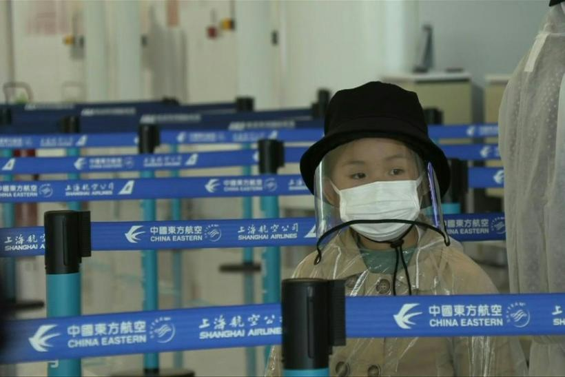 IMAGESPassengers arrive and check in for flights at Wuhan Tianhe Airport as China lifts a travel ban on residents of the central city, where the coronavirus pandemic began last year.