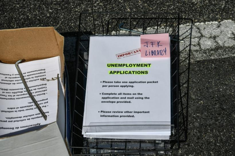 Unemployment forms at a drive-through collection point outside John F. Kennedy Library in Hialeah, Florida -- at least 17 million Americans have been pushed out of their jobs since mid-March, 2020 by the coronavirus pandemic