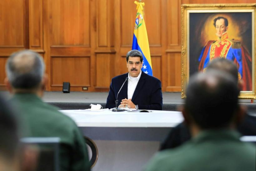 """President Nicolas Maduro, shown in a handout picture released by the Venezuelan Presidency speaking to members of the Bolivarian National Armed Forces (FANB), announced that two Americans were arrested for taking part in the failed """"invasion"""""""