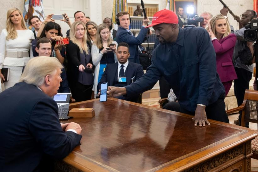 President Donald Trump meeting rapper Kanye West in the White House on 11 October 2018