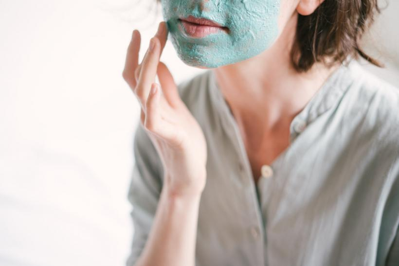 woman-applying-face-mask-3059403
