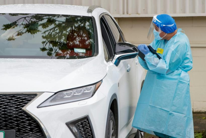 A health worker conducts a test at a COVID-19 coronavirus testing centre in the suburb of Northcote in Auckland