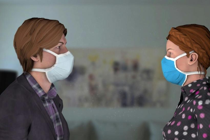 A videotraphic showing the levels of protection provided by the wearing of face masks when near an infected person