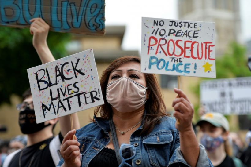 A demonstrator holding a 'Black Lives Matter' sign is seen taking part in an anti-racism protest in Boston, Massachusetts on May 29, 2020