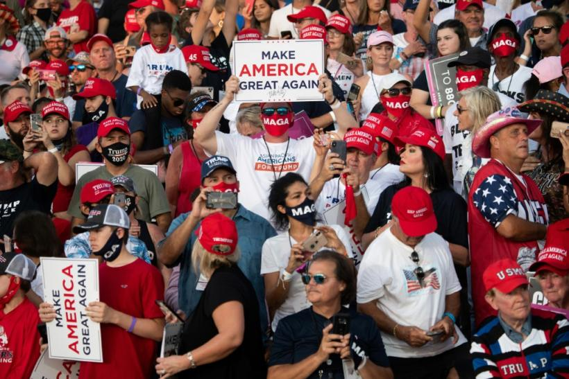 Supporters of US President Donald Trump attend a rally at Orlando Sanford International Airport in Sanford, Florida