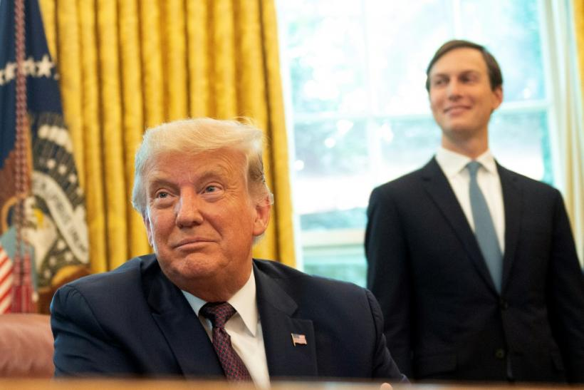 Jared Kushner stands next to his father-in-law, US President Donald Trump, as they announce Bahrain's recognition of Israel in September 2020