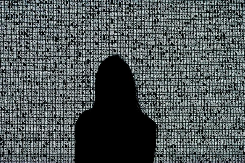 A woman looks at an NFT by Ryoji Ikeda titled 'A Single Number That Has 10,000,086 Digits' during a media preview at Sotheby's in New York ahead of an NFT auction June 10, 2021
