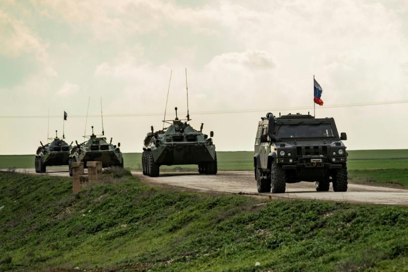In this file photo taken on February 22, 2020 Russian military vehicles patrol the M4 highway in the northeastern Syrian Hasakeh province on the border with Turkey