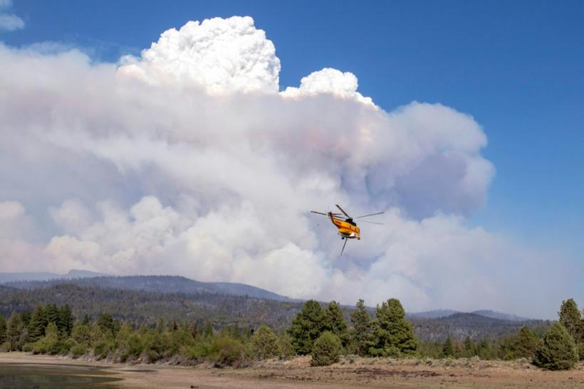 Helicopters loaded with water flew over the Bootleg Fire, 27 miles northeast of Klamath Falls, near Bly, Oregon