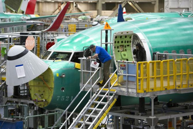 This file photo dated March 27, 2019 shows a Boeing employee working on a 737 MAX airplane at a factory in Renton, Washington; production was halted after two fatal crashes, and some employees blame a company culture of 'arrogance'