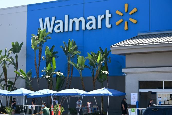 Walmart reported strong earnings behind higher sales at US stores, with consumers shopping less frequently, but spending more at each visit