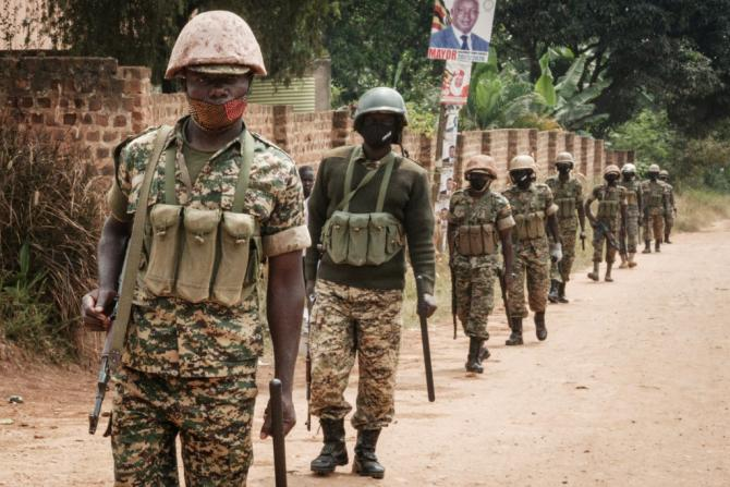 Soldiers pictured on patrol near Bobi Wine's home in Magere, on the outskirts of Kampala, where he has confined since the election