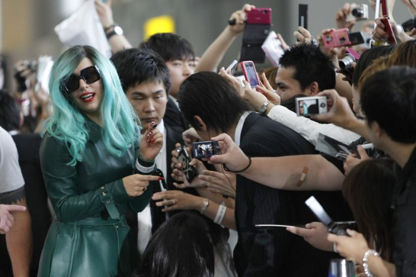 Lady Gaga signs autographs for fans upon her arrival at Narita International Airport