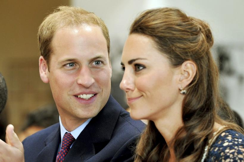 Britain's Prince William looks at his wife, Catherine, the Duchess of Cambridge