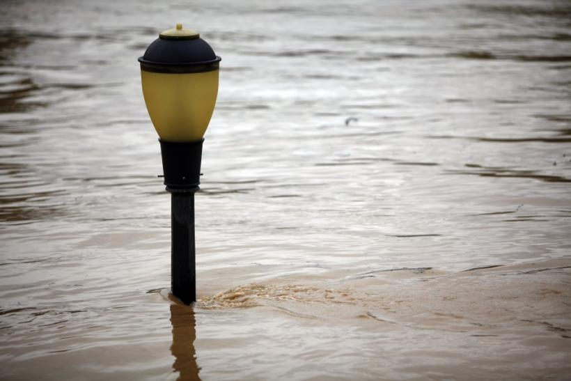 A streetlight is submerged by floodwaters from Susquehanna River in Kingston