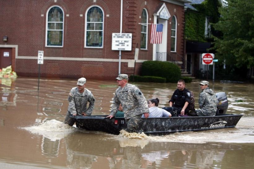 U.S. National Guard troops rescue David Rowlands and Linda Rowlands from floodwaters from the Susquehanna River in West Pittston