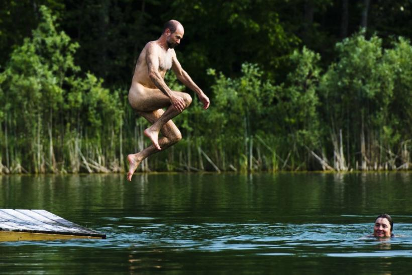 jumps into the water at the Bare Oaks Family Naturist park Reuters