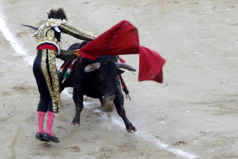 Spanish bullfighter Jose Tomas tries to kill a bull during the last bullfight