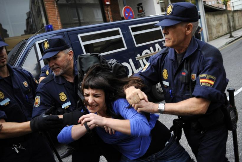 Stop Desahucios activists scuffle with police during a June 27 eviction in Oviedo, Spain