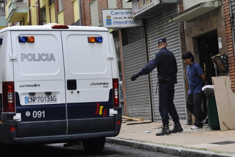 Police arrest Jorge Cordero, a homeowner, for resisting a June 27 eviction in Oviedo, Spain.