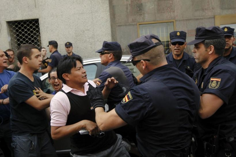 Demonstrators push back police trying to execute the June 27 evicition of Milagros Carbajo, in Madrid.