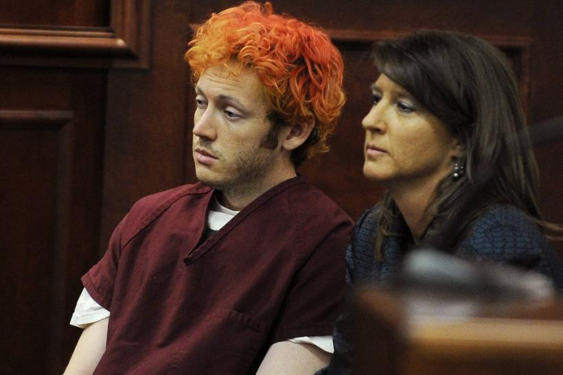 Colorado shooting suspect James Eagan Holmes sits with public defender Tamara Brady during his first court appearance in Aurora