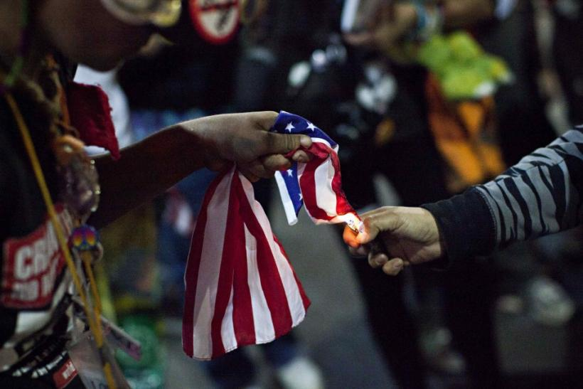 An Occupy Wall Street demonstrator burned an American flag during a protest Sunday.