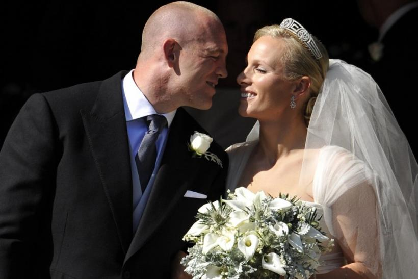 Britain's Zara Phillips prepares to kiss her husband Mike Tindall after their marriage at Canongate Kirk in Edinburgh