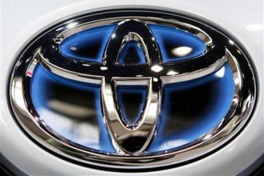 A Toyota logo is seen on the front of a plug-in Prius at the Chicago Auto Show