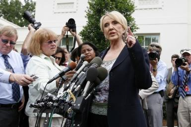 Arizona Republican Governor Jan Brewer signed into law on Thursday a controversial bill that bans most abortions after 20 weeks of pregnancy, giving Republicans a win in ongoing national efforts to impose greater restrictions on abortion.