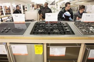 File image of shoppers looking at durable goods appliances at a Home Depot store in New York