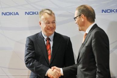 Nokia's new Chief Executive Stephen Elop (L) shakes hands with Nokia's Chairman of the Board Jorma Ollila during a news conference in Espoo Finland, September 10, 2010
